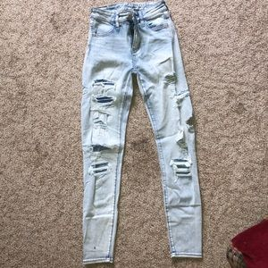 AE super stretch light washed ripped jeans